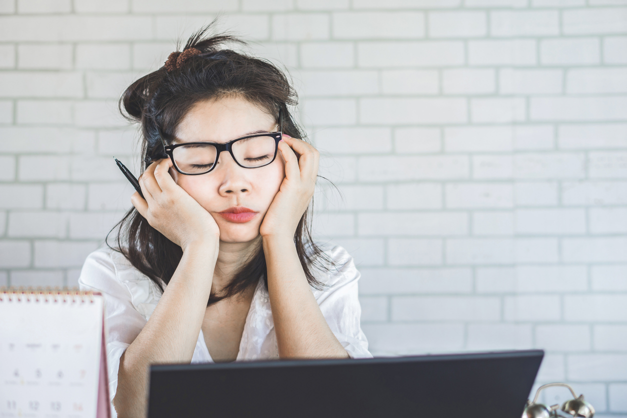 tired asian woman with glasses